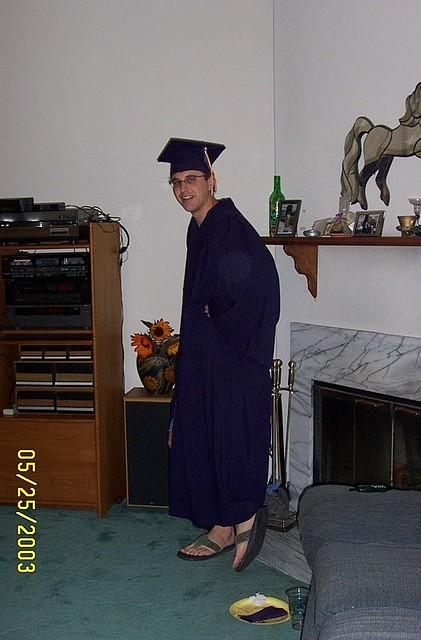 Cody rockin' the grad gown and flip-flops