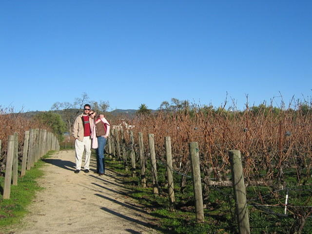 Mike and Emily amid the vines.