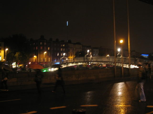 Ha' Penny Bridge, with rain and darkness (that blue light in the sky is the top of the Millennium Spire).