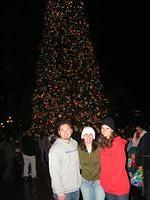 long-hai, nuala, and kristen in front of the xmas tree.