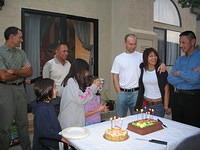 Frank, Bethany, Mario, Samantha, Becca (behind Samantha), George, Jen, Albert getting ready for cake