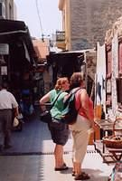 mary and i looking at stuff in monastiraki, athens (street-market shopping area).  also in the picture is a grafitti wall that i