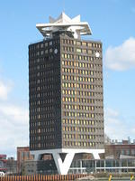 This building is equipped with helicopter blades in case there is danger on the ground. (A Royal Dutch/Shell building)