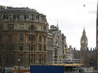 Big Ben and sundry buildings. The famous Trafalgar lions are covered in scaffolding.