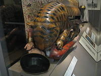 Indian automaton. When you turn it on, the man waggles his arm and screams and the tiger emits growling and crunching sounds. Sa