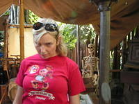the beginning of my photos where we mimic something in the background.  christine pretends to be a skeleton.