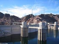 The Hoover Dam, with its intake towers (each 63 feet across at the top and 395 feet tall) that anchor the dam and allow in water