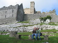 "Outside the Rock of Cashel (or maybe ""at the base of the Rock of Cashel)."