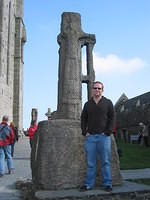 Matt with a replica of St. Patrick's Cross (the real one is inside the building to the right there).
