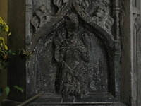 Figure of Christ on a tomb in St. Andrew's Church, with its head smashed off by Cromwellian invaders.