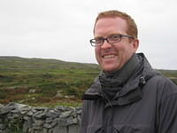 Matt on his way to Dun Aenghus, chuckling at a joke he made about the cows.